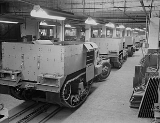 M2 half-track car - Partly finished M2s travel along an assembly line.
