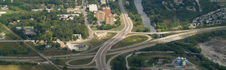 Hanlon Expressway - Wellington Street interchange facing east. Highway 7 and former Highway 24 travel into the distance; Highway 6 travels south (right); former Highway 24 travels west (down); and Highway 6 and 7 travel north (left).