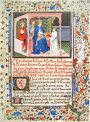 Illuminated manuscript with many colorful designs all around the margins. On the lower half of the page is calligraphic text. On the upper half is an image of a kneeling monk in a white robe giving a book to a seated pope who is wearing a lavish dark blue robe. Two assistants stand behind him.