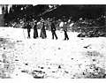 Hikers with walking sticks crossing over snow in Paradise Valley, Mount Rainier National Park, August 1902 (WASTATE 1463).jpeg