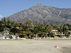 Costa del Sol - A beach on the Costa del Sol, with Sierra Blanca in the background