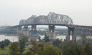 Huey P. Long Bridge (Jefferson Parish) cantilevered steel through truss bridge that carries a two-track railroad line over the Mississippi River at mile 106.1 with three lanes of US 90 on each side of the central tracks