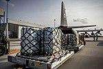 Hulpgoederen, klaar voor het inladen in een C-130 Hercules-transportvliegtuig.jpg