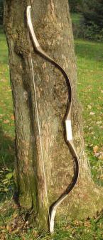 Bow and arrow - A modern reconstruction, in fiberglass and wood, of a historical composite bow