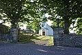 Hvasser kirke 1903 1908 Færder kommune, Norway 2020-07-02 Port iron gate Steingjerde stone fence White wooden church Summer DSC01833.jpg