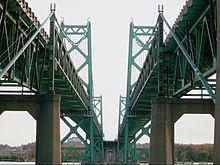 Parallel bridges cross a river