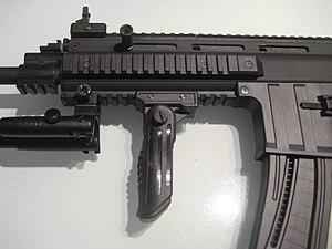 Vertical forward grip - ISSC MK22 rifle with a vertical forward grip.