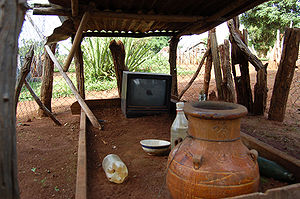 Jarai people - TV and offerings made to the spirit of the deceased in a small Jarai tomb in Kon Tum Province