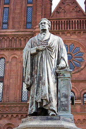 Smithsonian Institution Building - A statue of Joseph Henry is displayed in front of the building.