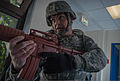 Juergen Britt, a first responder with the 86th Security Forces Squadron, clears a hallway during an active-shooter training scenario April 9, 2014, at Ramstein Air Base, Germany 140409-F-YC884-200.jpg