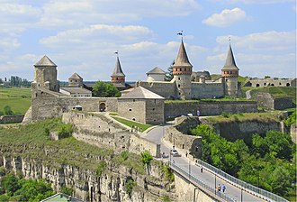 Kamianets-Podilskyi Castle - Seven of the castle's original twelve towers dominate over the surrounding Smotrych River canyon landscape.