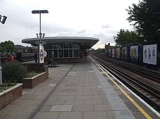 Kilburn tube station - Westbound platform looking east, with a Jubilee line train arriving in the distance.