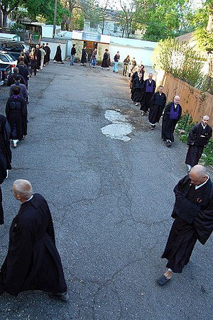 Buddhist meditation - Members of Kanzeon Zen Center during walking meditation