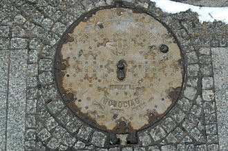 Manhole cover - Kraków manhole cover (note integral hinge).