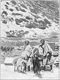1898 photo of Tibetan with yak and a sheep carrying a bag of salt