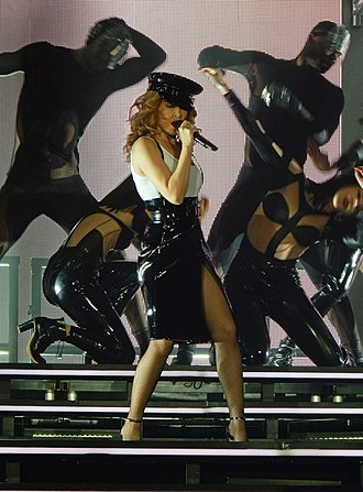 Can't Get You Out of My Head - Minogue performing the song, as part of her Kiss Me Once Tour, on 2014.