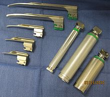 Laryngoscope handles with an assortment of Miller blades