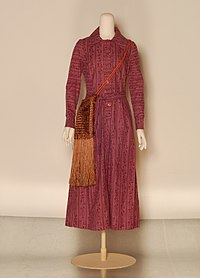Late 1960s pink and purple cotton print dress by Laura Ashley with fringed shoulder bag.jpg