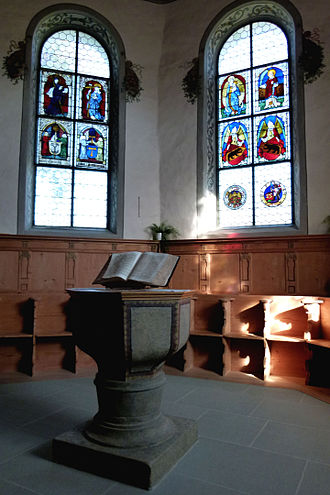 Lauperswil - Baptismal font and stained glass windows in the village church