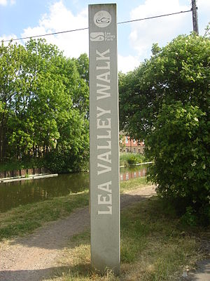 Lea Valley Walk - Signpost above Enfield Lock. A glimpse of Government Row in the background. Note the variant spellings of the river