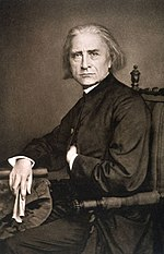 Liszt, photo by Franz Hanfstaengl, June 1867.