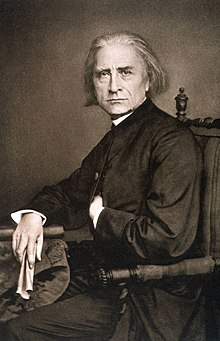 Liszt, photo (mirror-imaged) by Franz Hanfstaengl, June 1867 (Source: Wikimedia)