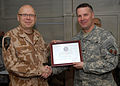 Lt.Col. Petr Kral receives a Staff Superhero Award (4546972983).jpg