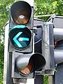 Luxembourg Traffic signal green arrow left.JPG