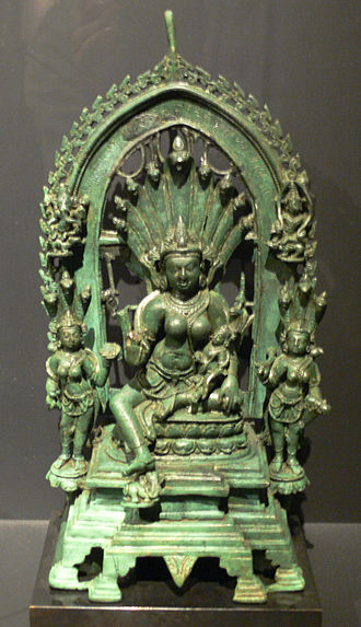 Manasa - Manasa with Astika on her lap, 10th century Pala bronze from modern-day Bihar.