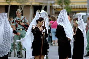 Mantilla - Mantilla made of white lace, during ritual procession in Spain.