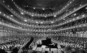 Metropolitan Opera - A full house at the old Metropolitan Opera House, seen from the rear of the stage, at a concert by pianist Josef Hofmann, November 28, 1937