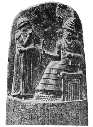 Shamash - Shamash (seated), depicted as handing symbols of authority to Hammurabi (relief on the upper part of the stele of Hammurabi's code of laws
