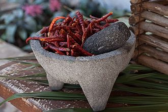 Mexican cuisine - A molcajete and tejolote, the traditional mortar and pestle of Mexico.