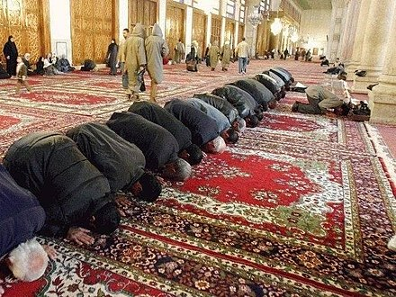 Muslim men prostrating in prayer, at the Umayyad Mosque, Damascus. Mosque.jpg