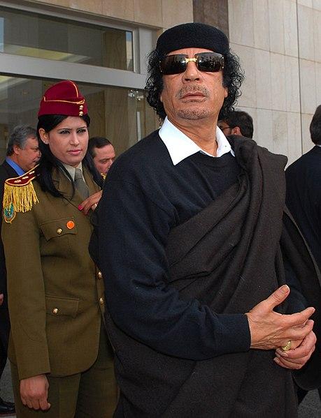 http://upload.wikimedia.org/wikipedia/commons/thumb/e/e5/Muammar_Abu_Minyar_al-Gaddafi_in_Dimashq%2C_Syria.jpg/459px-Muammar_Abu_Minyar_al-Gaddafi_in_Dimashq%2C_Syria.jpg