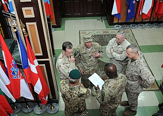 International Security Assistance Force - Kabul; Clock wise, Michael Mullen, David Petraeus, James Mattis, John Allen, Marvin L. Hill and German Army Gen. Wolf Langheld inside the ISAF headquarters in Kabul.