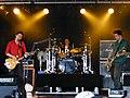 Muse at Roskilde Festival 2000 (4688870002).jpg