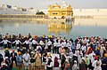 Narendra Modi at the Golden Temple, in Amritsar, Punjab. The Chief Minister of Punjab, Shri Parkash Singh Badal, the Minister of State for Social Justice & Empowerment, Shri Vijay Sampla and other dignitaries are also seen.jpg