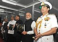 Narendra Modi releasing the Photo Essay book on 'Maritime Heritage of India', at the International Fleet Review-2016, at Visakhapatnam. The Governor of Andhra Pradesh and Telangana, Shri E.S.L. Narasimhan (1).jpg