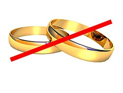 Red slash across a pair of wedding rings