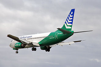 Nauru Airlines - An Our Airline Boeing 737-300 operating for Norfolk Air landing at Sydney Airport, Australia. (2010)