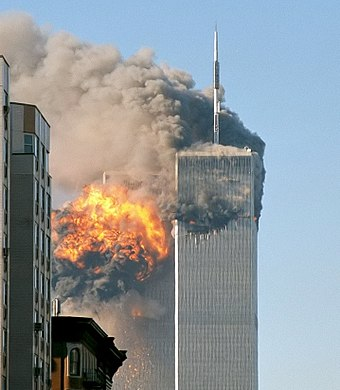 The World Trade Center in New York City as seen on September 11, 2001. Flight 175 has just flown into the South Tower. North face south tower after plane strike 9-11.jpg