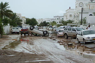 Cyclone Gonu - Flipped car and flooding on a street in Muscat, Oman