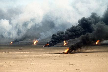 Oil fires rage outside Kuwait City, 1991. Public domain.