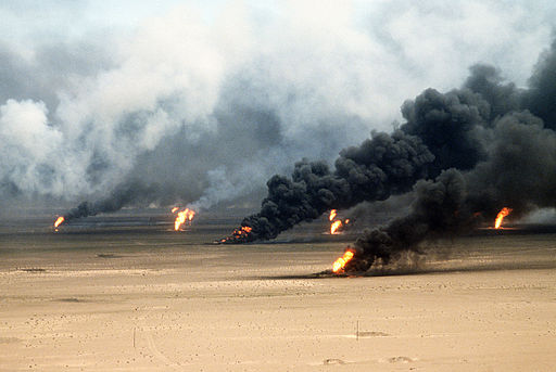 Oil well fires rage outside Kuwait City in the aftermath of Operation Desert Storm. Photo by Tech. Sgt. David McLeod. Public Domain.