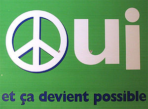 "Quebec referendum, 1995 - Election sign for the ""Yes"" side. Others versions featured a loonie coin, a globe, a flower, ♀, and a ""men working"" traffic sign in place of the ""O."""