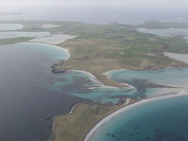 An aerial view of the southern coast of Sanday, looking west. Tres Ness and Conninghole are in the foreground.