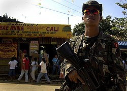 A Philippine Army soldier standing on guard in Pantao Ragat in 2007.
