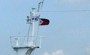 Philippine coastwise emblem - The Philippine coastwise emblem along with the Philippine flag flown at the main-mast of Montenegro Lines's MV Maria Diana.