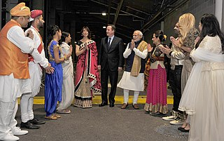 Samantha Cameron in a saree with David Cameron welcoming Indian Prime Minister Modi, 13 November 2015